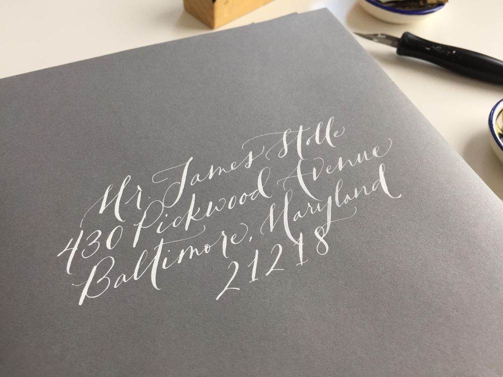 white ink on grey envelopes - image 2 - student project