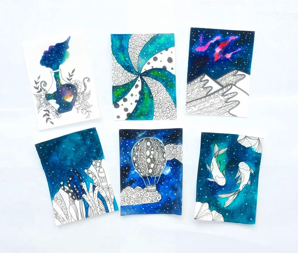 Ink and watercolor galaxy doodles - image 1 - student project