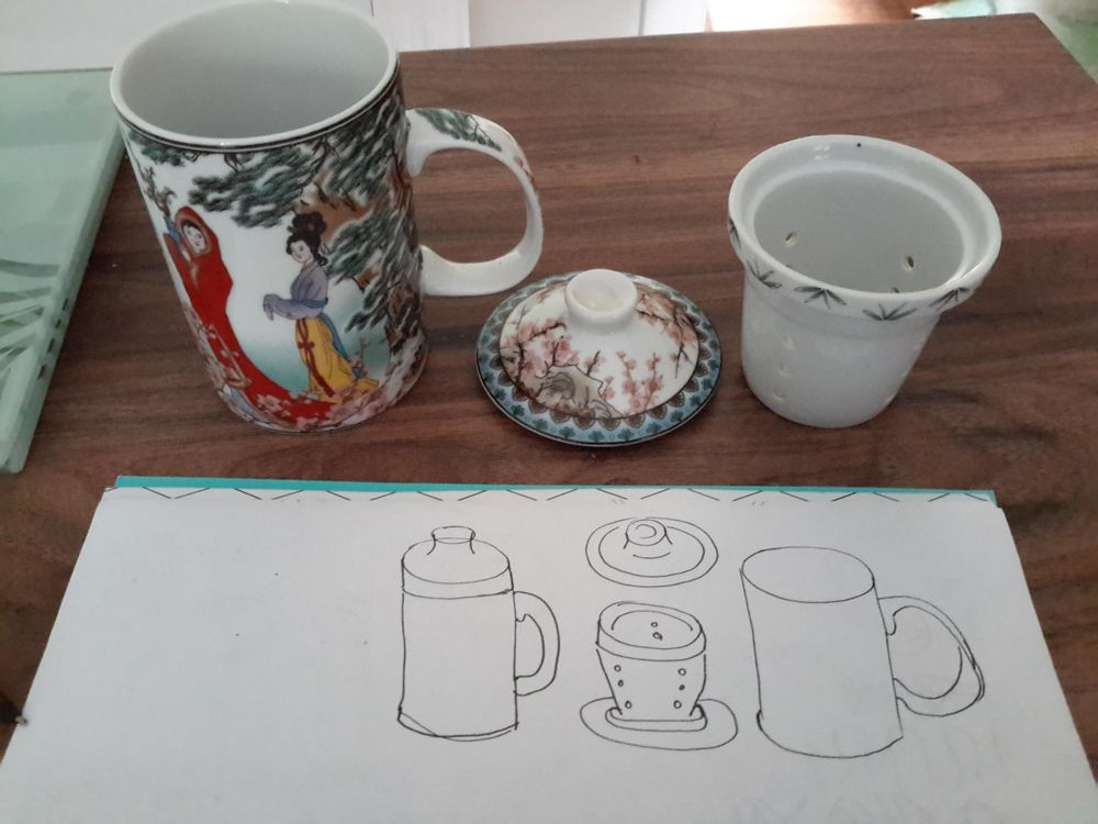 Things in my house Chinese tea cup, pestle and mortar and ring on nail varnish - image 1 - student project