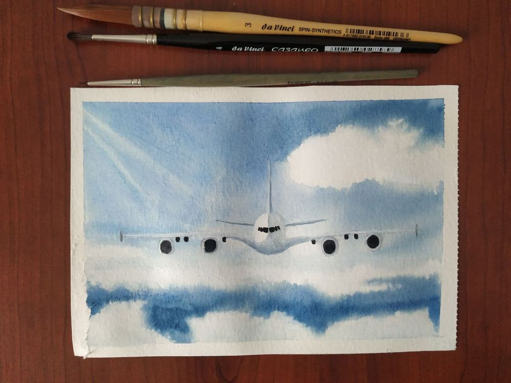Airplane over clouds - image 1 - student project