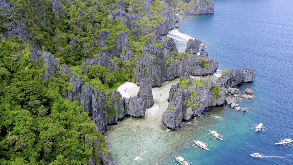 Aerial fly over of Secret Beach, El Nido in Palawan, Philippines - image 1 - student project