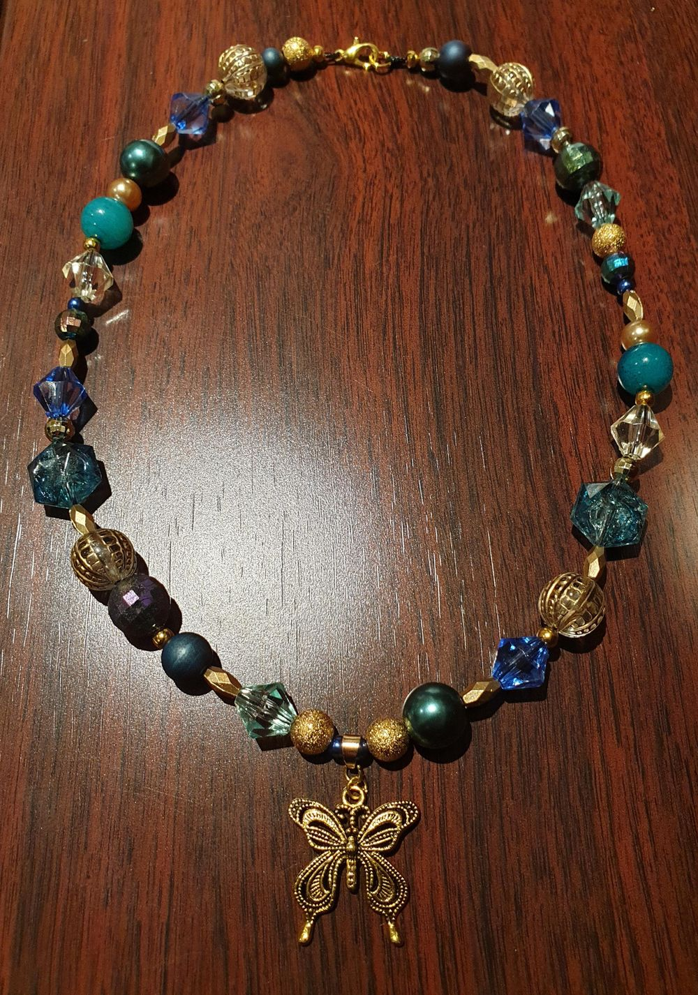 Beaded necklace with butterfly charm - image 1 - student project
