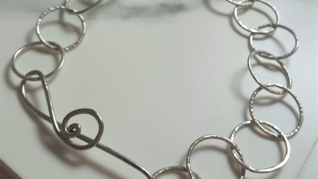 Treble clef hammered bracelet - student project