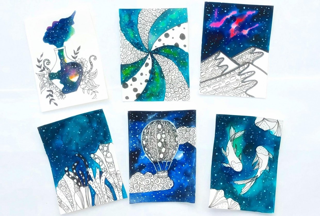 Ink and watercolor galaxy doodles - student project