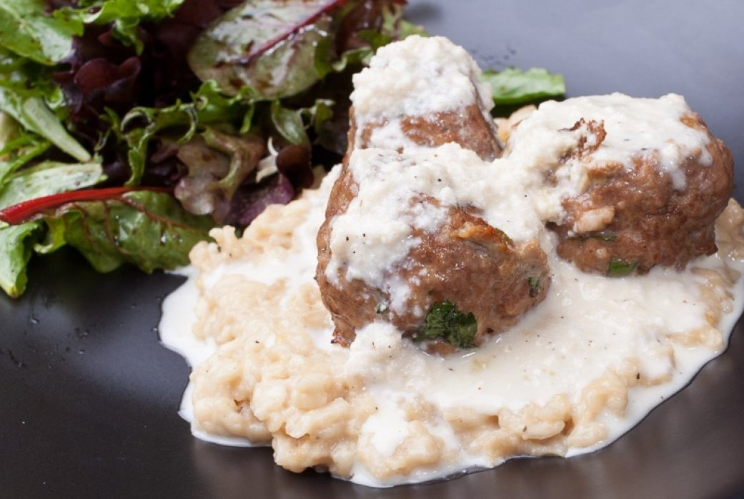 Beef meatballs over lemon risotto with parmigiano-reggiano cream sauce - student project
