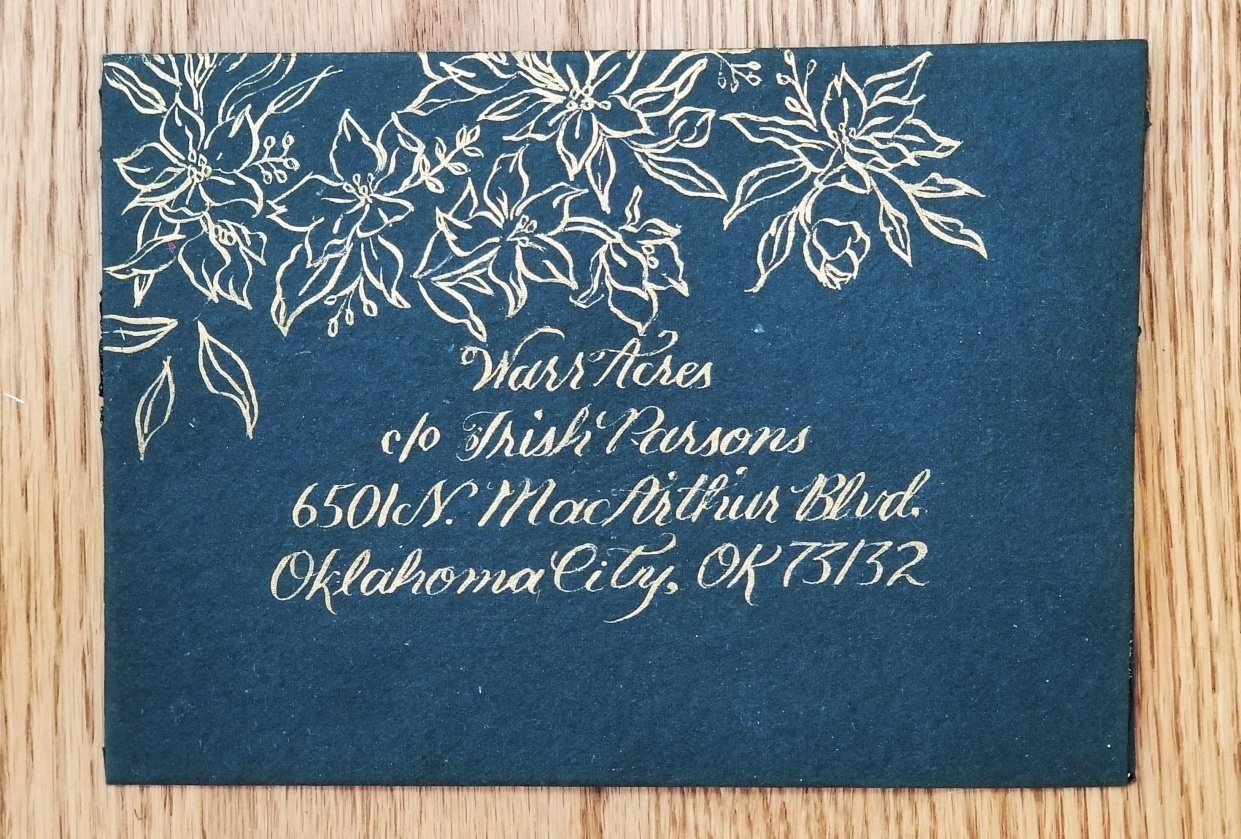 Gold flowers on a handmade envelope. - student project