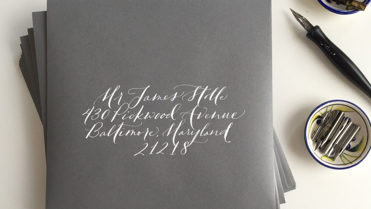 white ink on grey envelopes - student project