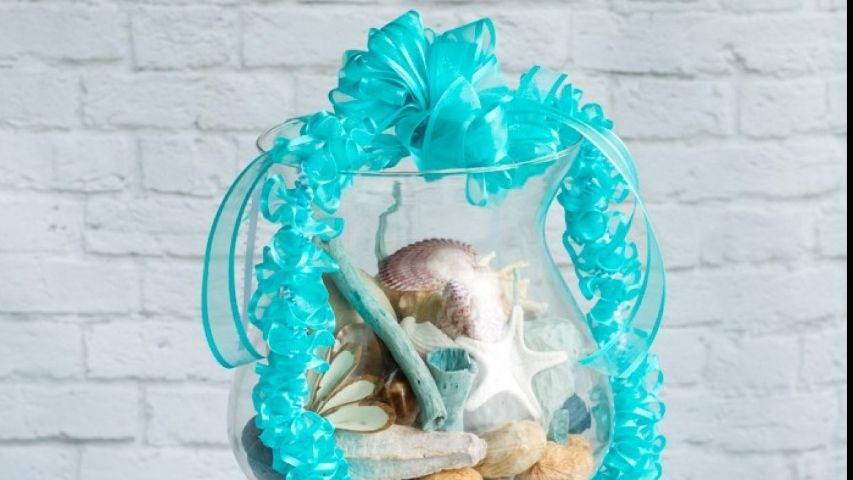 Turquoise and White Spiral Ribbon Lei - student project