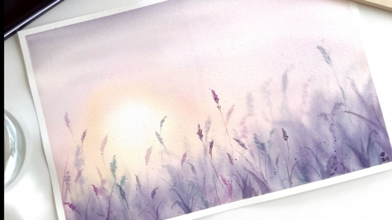 Watercolor sunset in the field