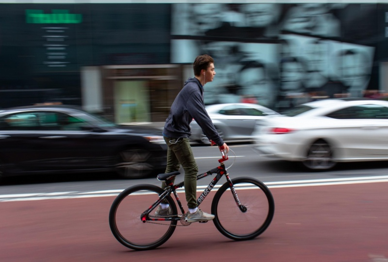 Motion Blurred Shot - Teenager on bike in midtown