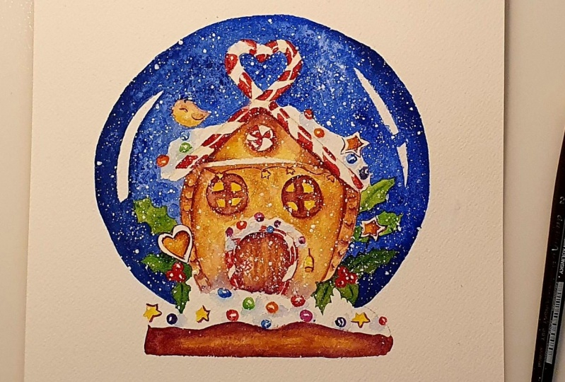 Snowglobe with a Gingerbread House