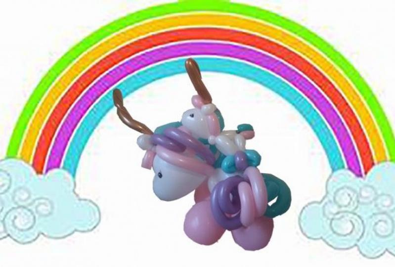 Balloon unicorn against a rainbow