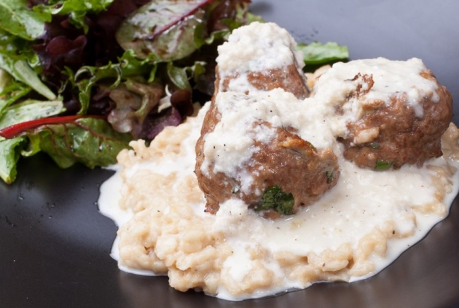 Beef meatballs over lemon risotto with parmigiano-reggiano cream sauce