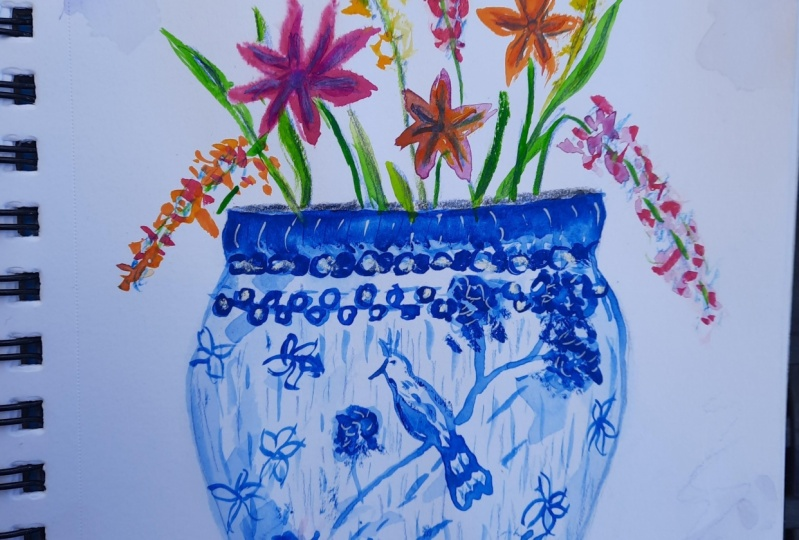 blue peacock vase and flowers