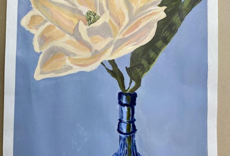 Magnolia flower in a blue vase