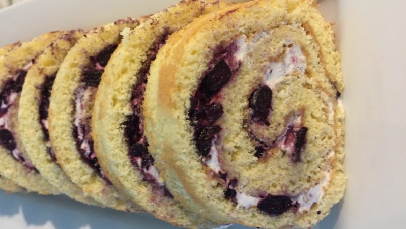 Lemon Genoise with a blueberry jam and whipped cream filling.